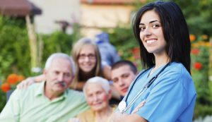 Confident doctor welcoming multigenerational family in residential care home.